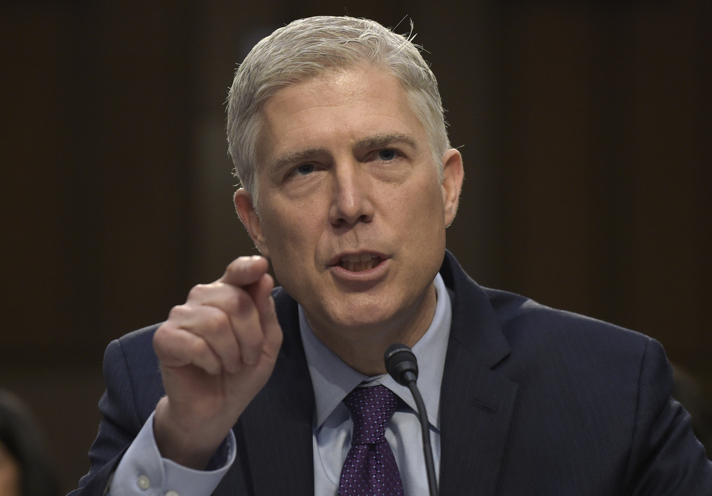FILE - In this March 21, 2017 file photo, Supreme Court Justice nominee Neil Gorsuch testifies on Capitol Hill in Washington during his...
