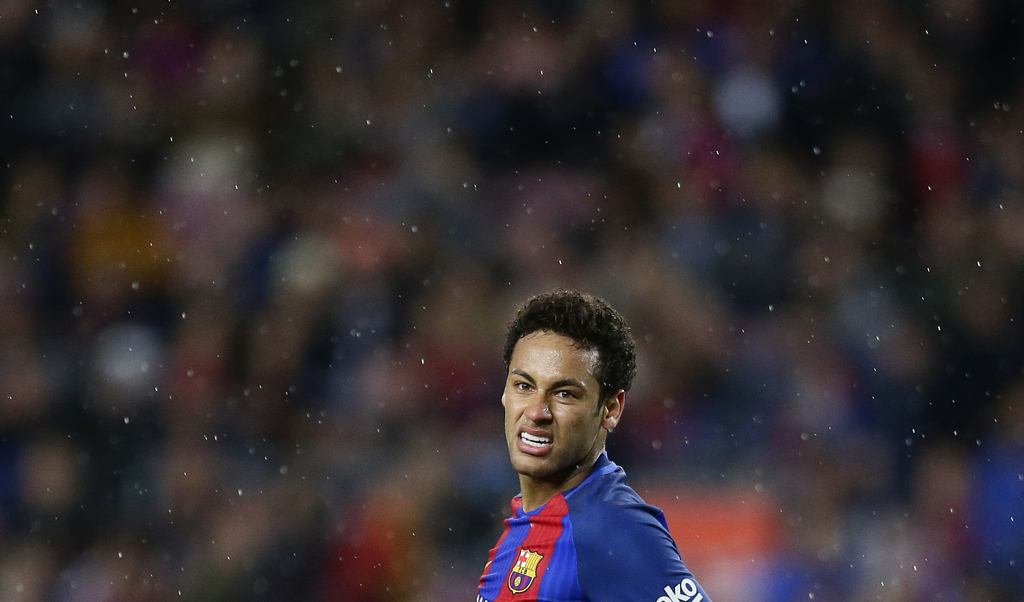 FC Barcelona's Neymar reacts during the Spanish La Liga soccer match between FC Barcelona and Sevilla at the Camp Nou stadium in Barcel...