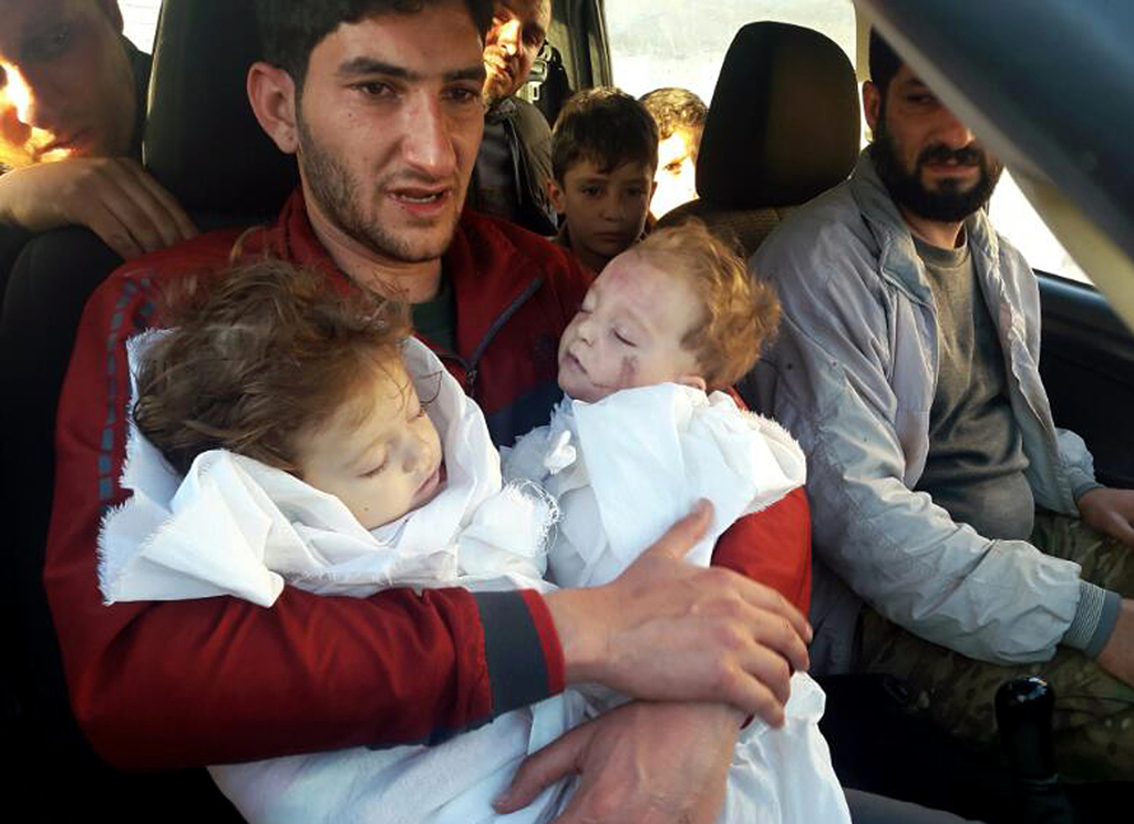In this picture taken on Tuesday April 4, 2017, SAbdul-Hamid Alyousef, 29, holds his twin babies who were killed during a suspected che...