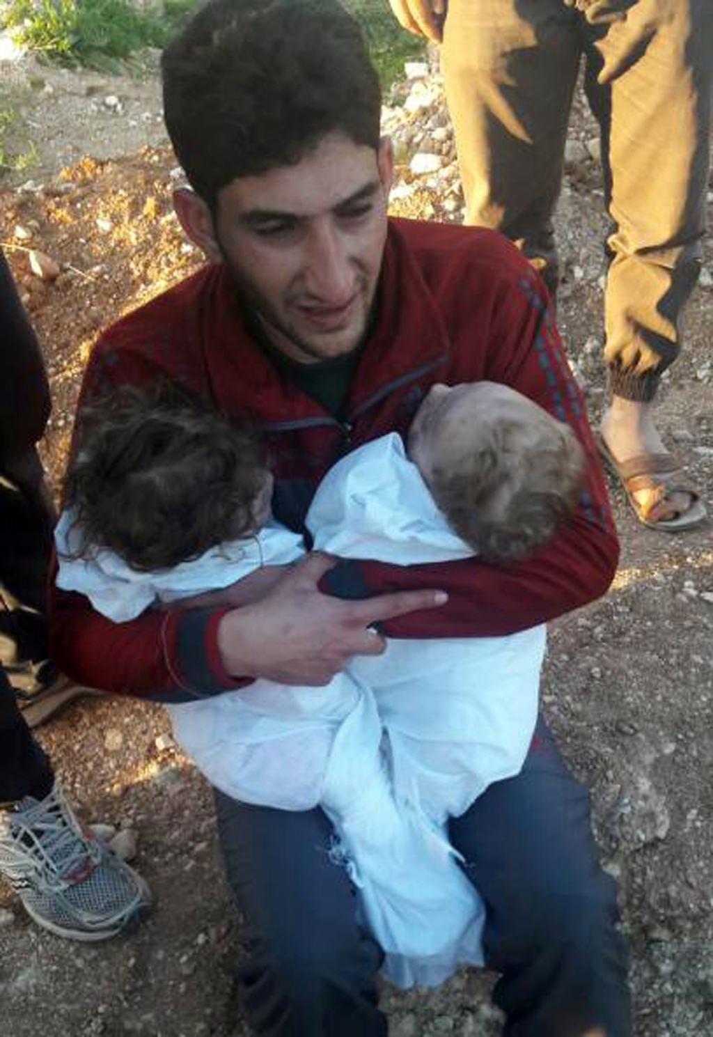 In this picture taken on Tuesday April 4, 2017, Abdul-Hamid Alyousef, 29, cries as he holds his twin babies who were killed during a su...