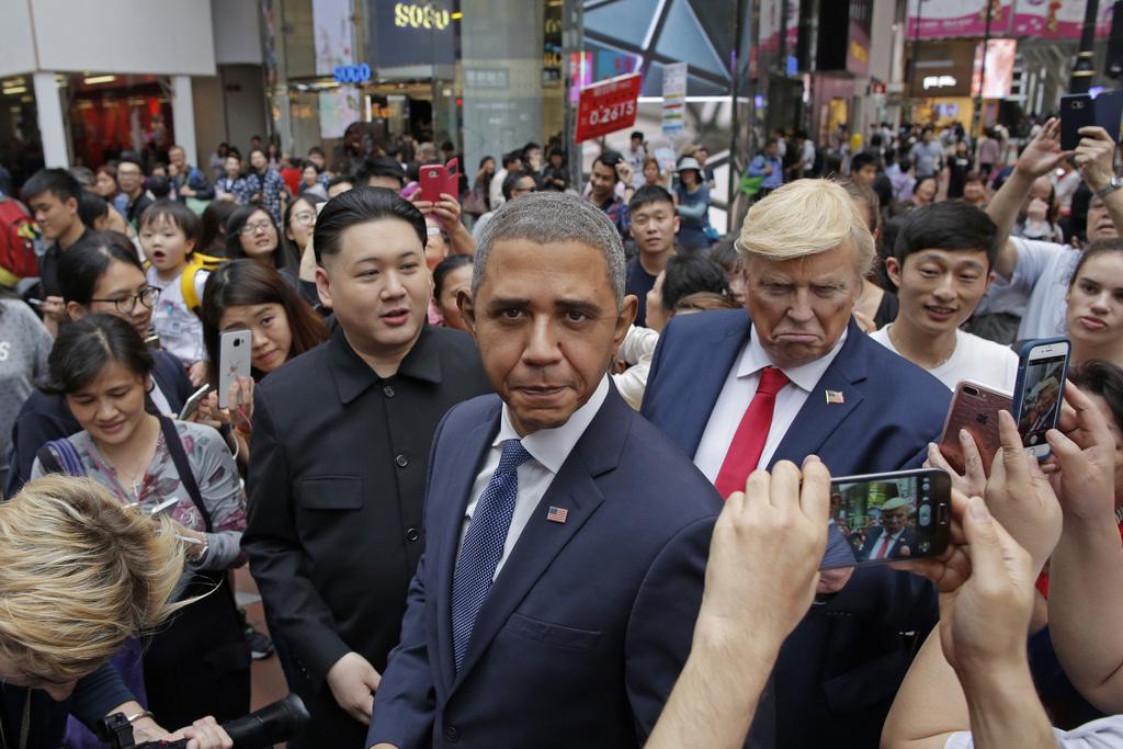 Impersonators of North Korean leader Kim Jong Un, former U.S. President Barack Obama and U.S. President Donald Trump, from left, Howard...