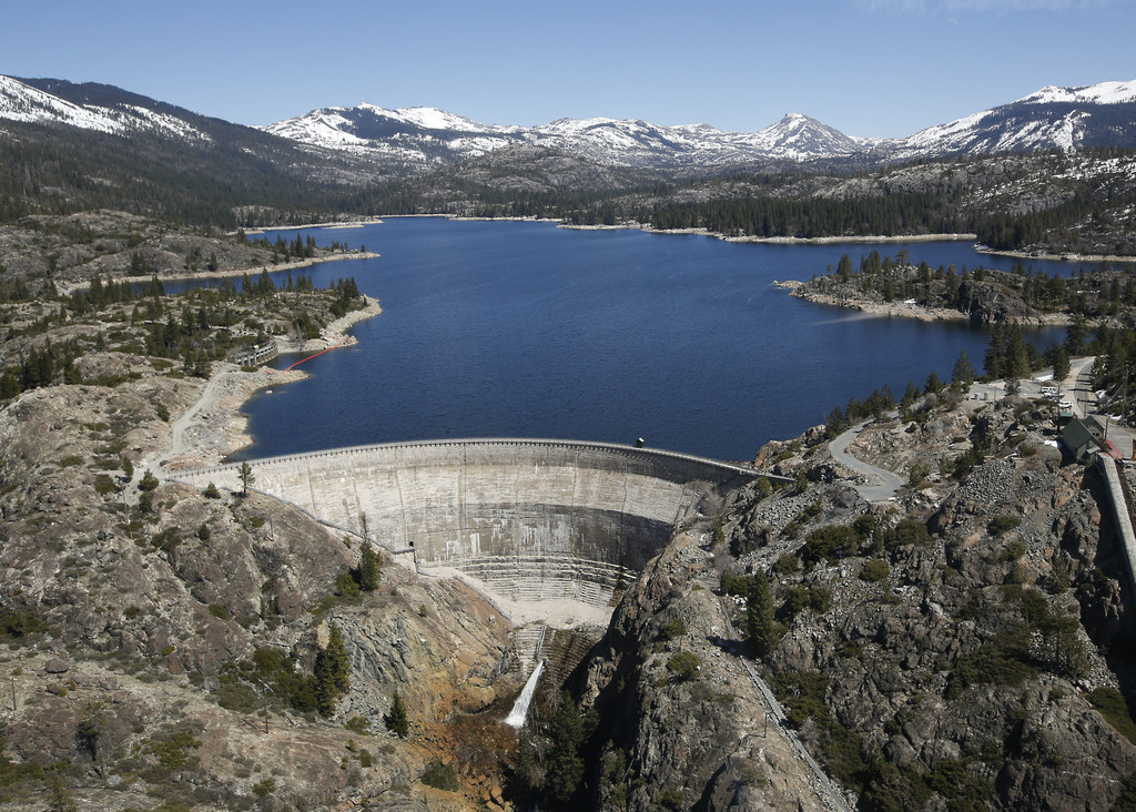 In this April 3 2017 photo, snow covering the Sierra Nevadas is seen in the background of the PG&E hydroelectric dam at Spaulding Lake ...