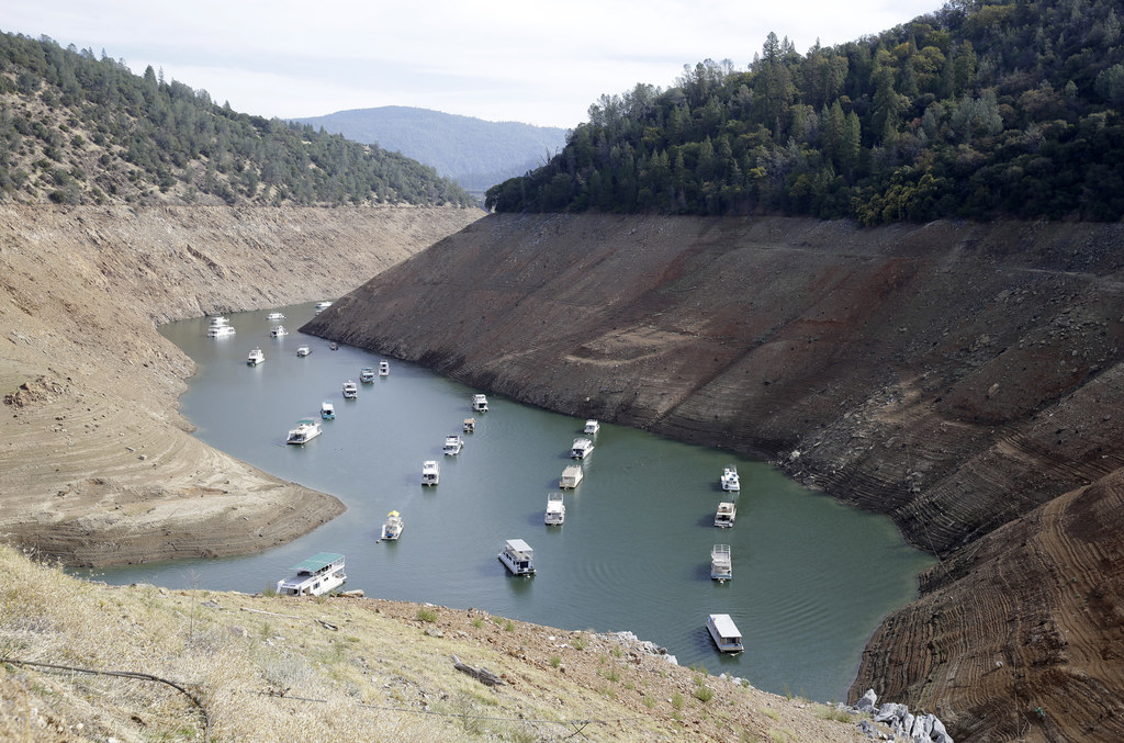 FILE - In this Thursday, Oct. 30, 2014 file photo, houseboats sit in the drought lowered waters of Oroville Lake, near Oroville, Calif....