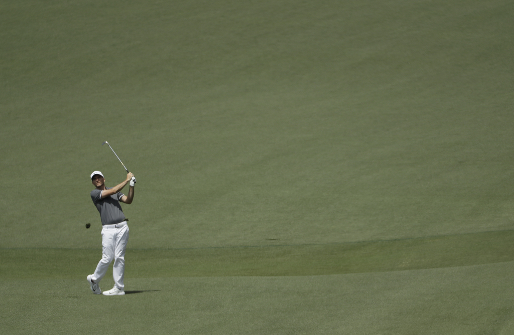 Russell Henley hits a shot to the second hole during the third round of the Masters golf tournament Saturday, April 8, 2017, in Augusta...