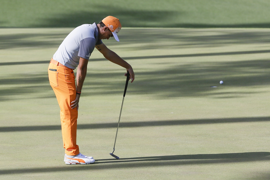 Rickie Fowler reacts after missing a putt on the 10th hole during the final round of the Masters golf tournament Sunday, April 9, 2017,...