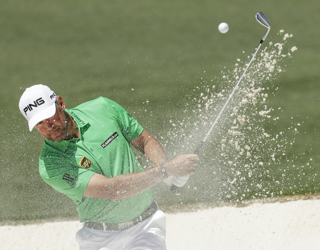 Lee Westwood, of England, hits from a bunker on the second hole during the final round of the Masters golf tournament Sunday, April 9, ...