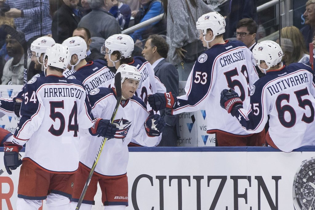 Columbus Blue Jackets' Cam Atkinson, centre left, celebrates after scoring against the Toronto Maple Leafs during second period NHL hoc...
