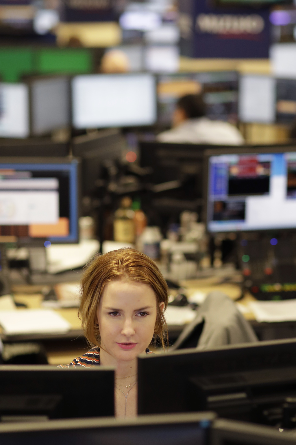 In this Jan. 12, 2017, photo, traders work on the Mizuho Americas trading floor in New York. Stocks are opening modestly lower on Wall ...