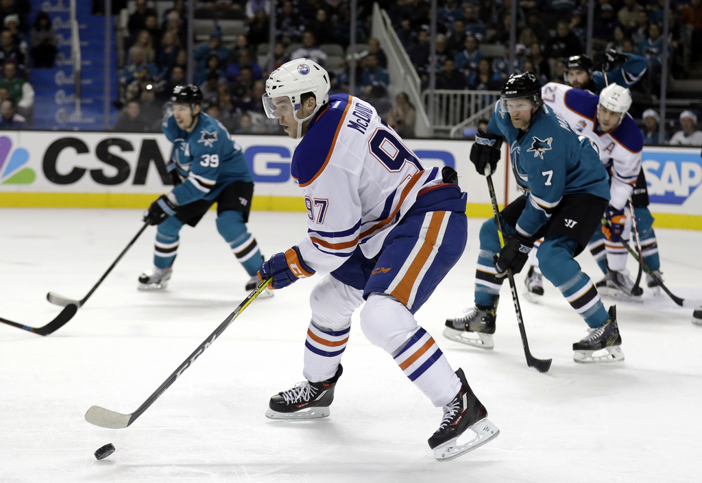 FILE - In this Dec. 23, 2016, file photo, Edmonton Oilers' Connor McDavid (97) controls the puck against the San Jose Sharks during the...