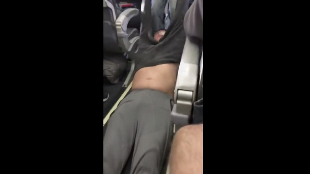 This Sunday, April 9, 2017, image made from a video provided by Audra D. Bridges shows a passenger being removed from a United Airlines...