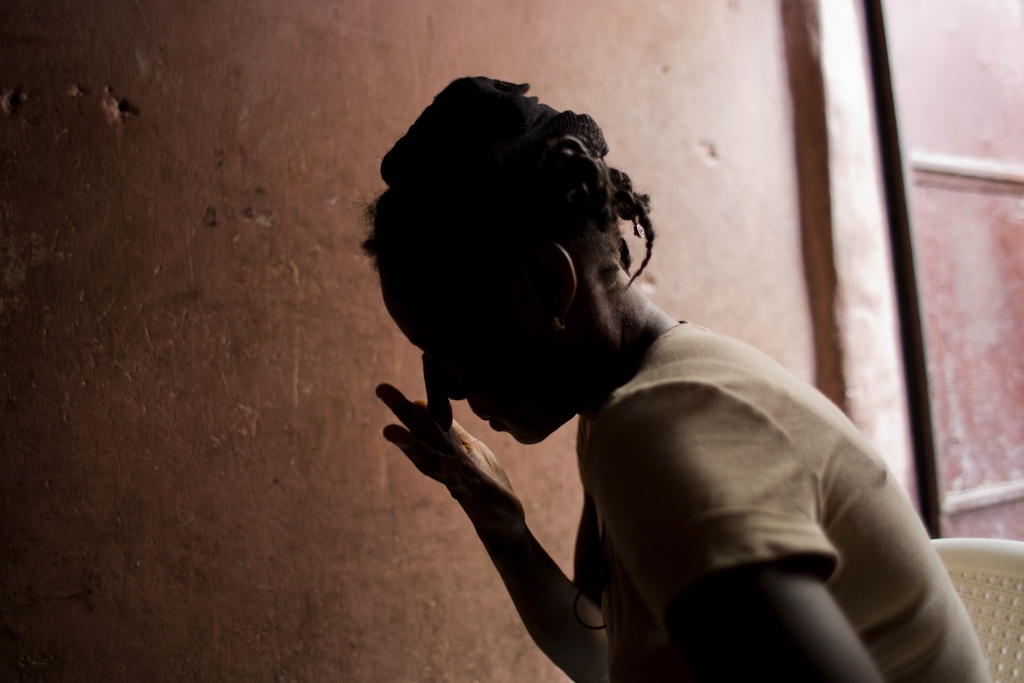 In this Aug. 11, 2016 photo, Martine Gestime 32, wipes her tears during an interview in Port-au-Prince, Haiti. Gestime said she was rap...