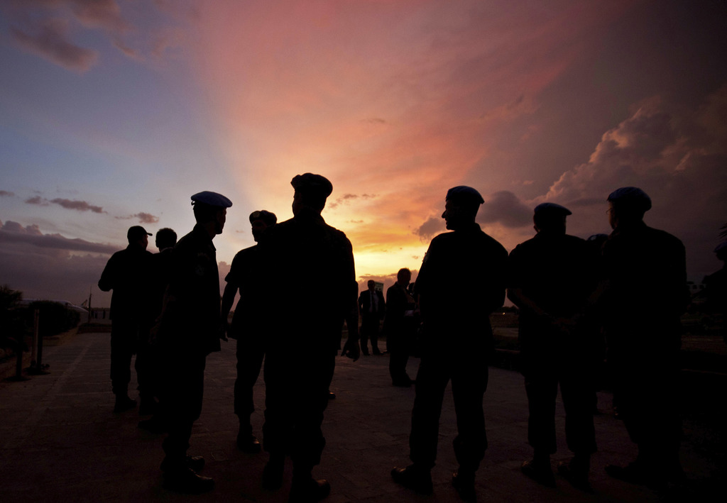 FILE - This Monday, July 11, 2011 file photo shows silhouettes of U.N. peacekeepers from Brazil at the airport in Port-au-Prince, Haiti...