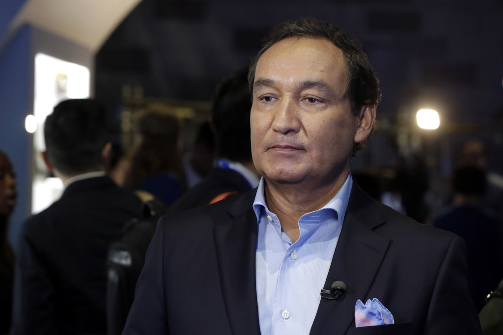 FILE - In this Thursday, June 2, 2016, file photo, United Airlines CEO Oscar Munoz waits to be interviewed, in New York, during a prese...
