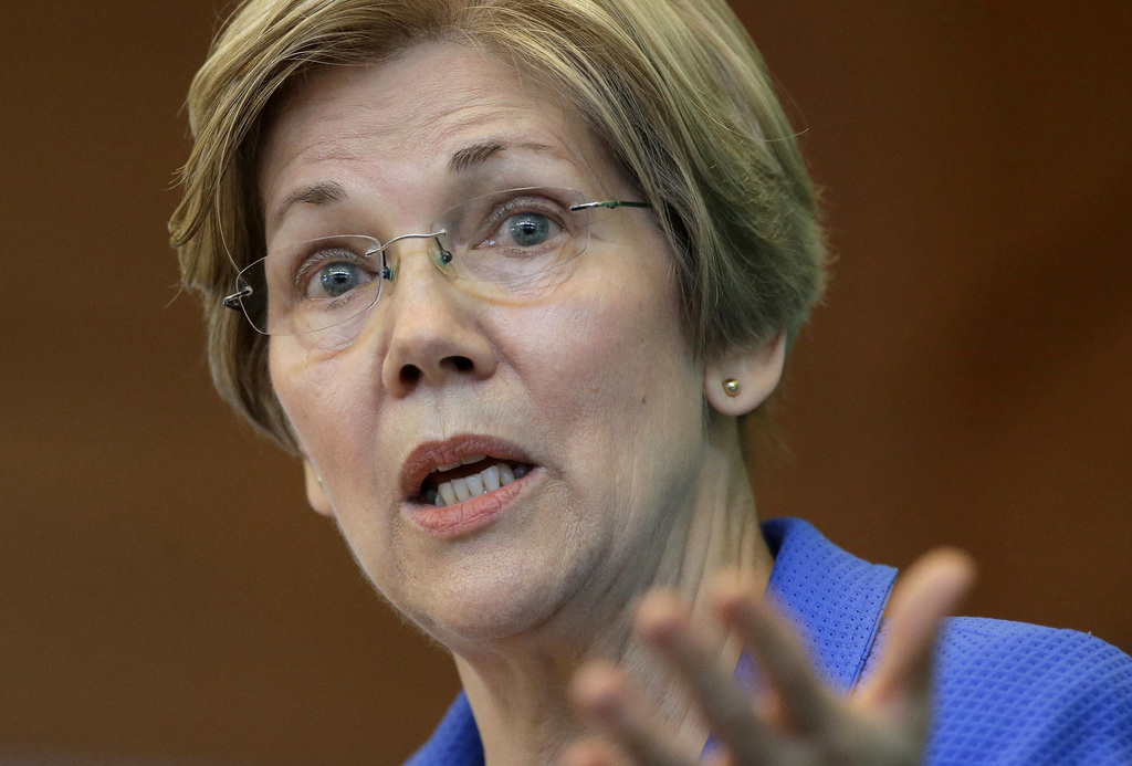 FILE- In this March 27, 2017, file photo, U.S. Sen. ElizabethWarren, D-Mass., addresses business leaders during a New England Council ...