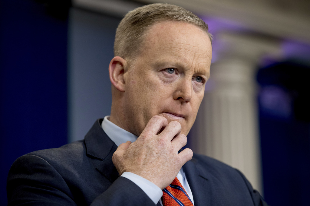 White House press secretary Sean Spicer pauses while talking to the media during the daily press briefing at the White House in Washing...