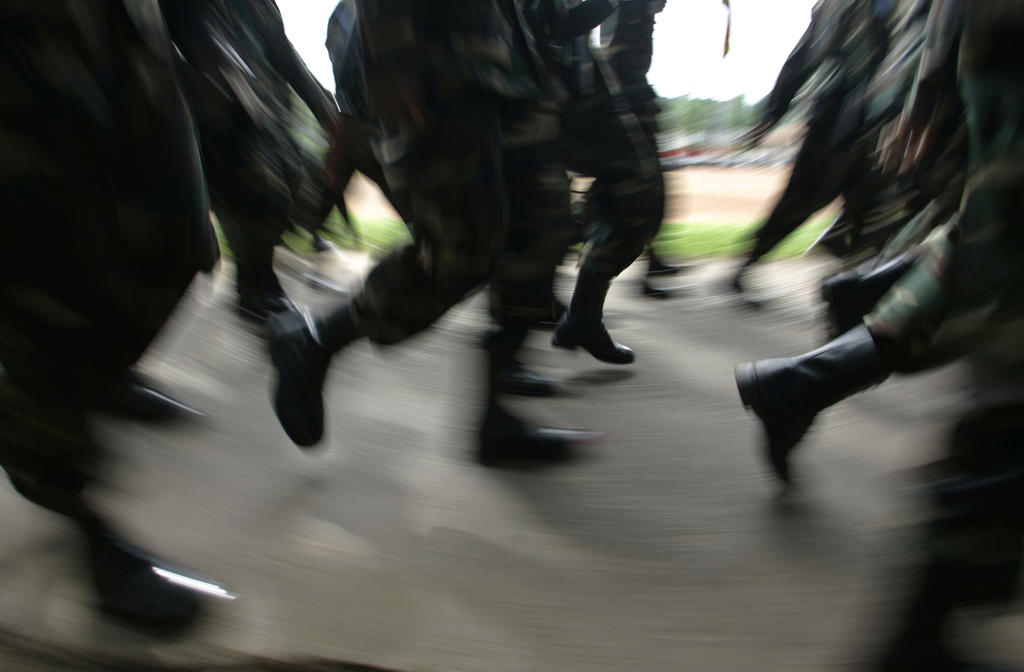 FILE - In this Wednesday, Dec. 3, 2008 file photo, Sri Lankan army soldiers trained as U.N. peacekeepers march during a ceremony in Pan...