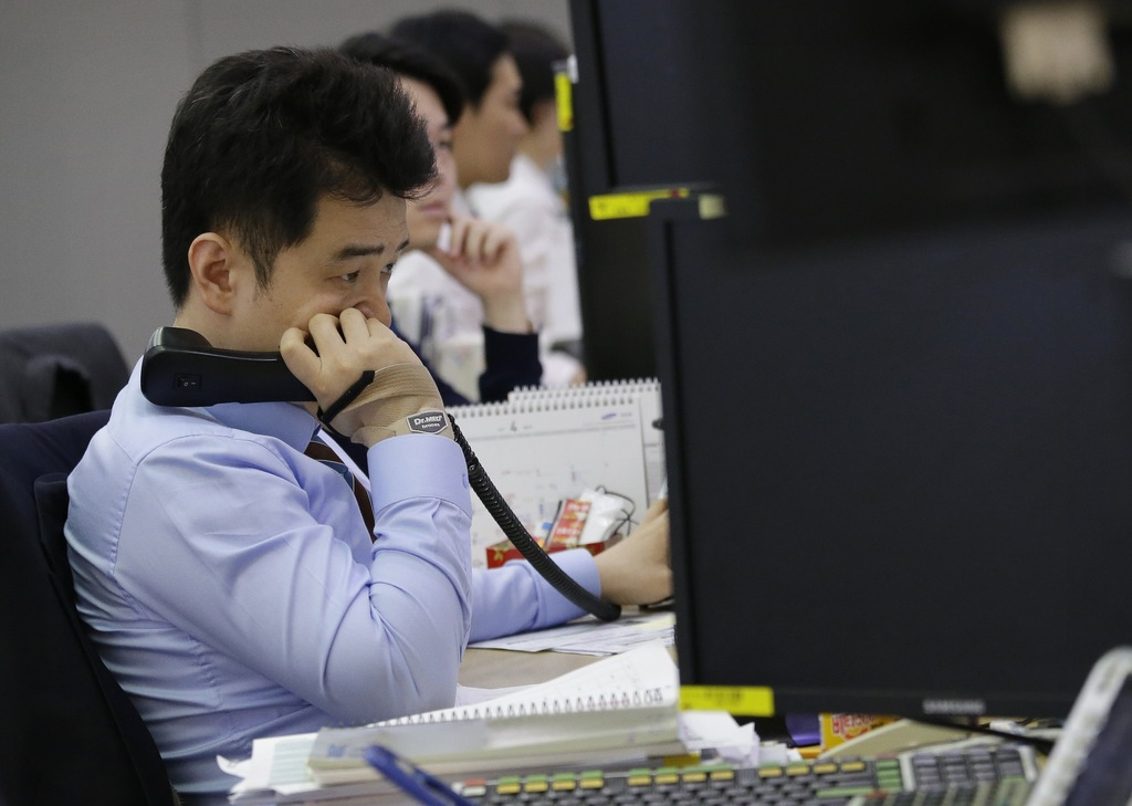 asian markets lower rattled by rising tensions in koreas taiwan a currency trader watches monitors at the foreign exchange dealing room of the keb hana bank headquarters in seoul south korea friday
