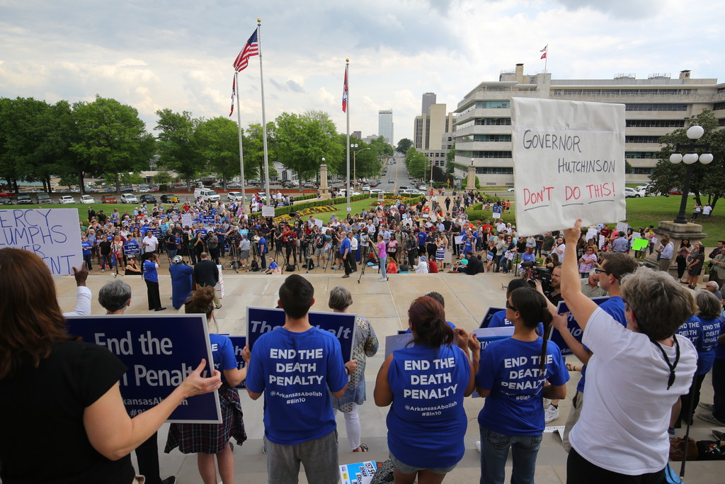 People gather at a rally opposing the state's upcoming executions, on the front steps of Arkansas' Capitol, Friday, April 14, 2017, in ...