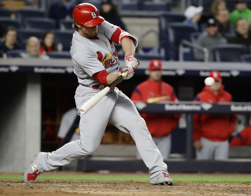 St. Louis Cardinals' Randal Grichuk hits an hits an RBI-double during the seventh inning of a baseball game against the New York Yankee...