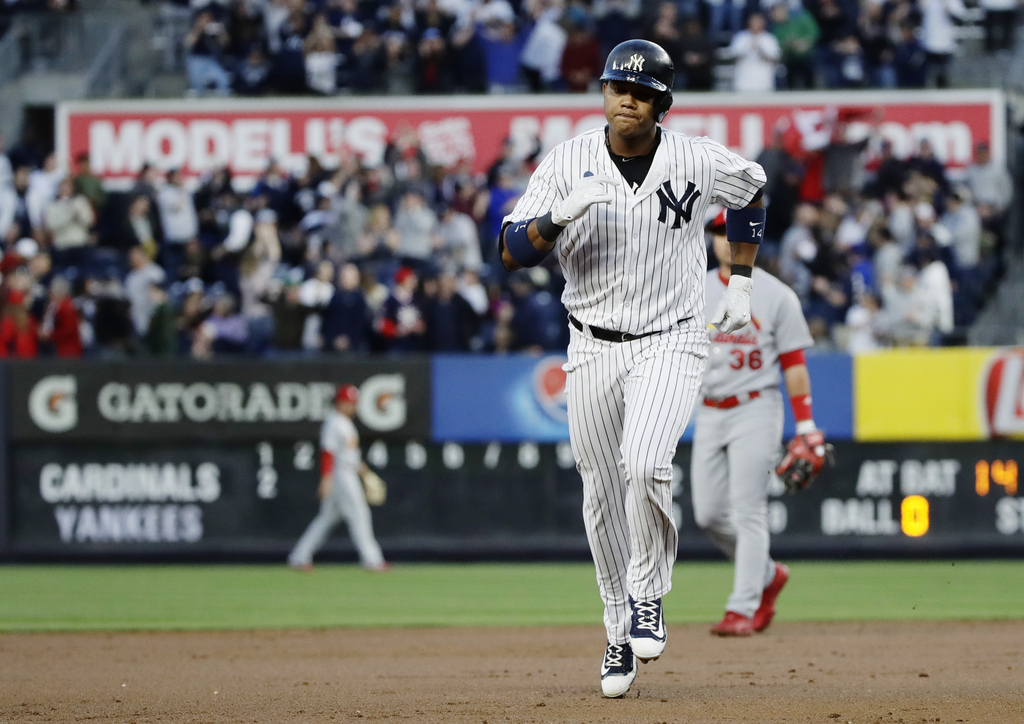 New York Yankees' Starlin Castro runs the bases after hitting a two-run home run during the first inning of a baseball game against the...
