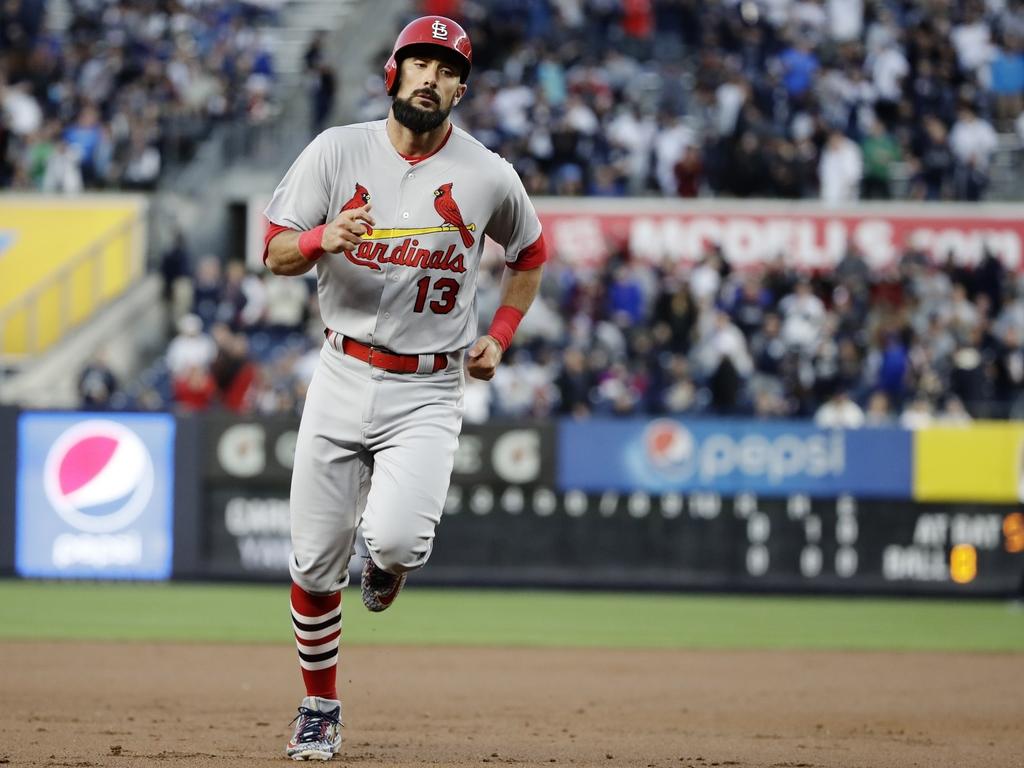 St. Louis Cardinals' Matt Carpenter (13) runs the bases after hitting a two-run home run during the first inning of a baseball game aga...