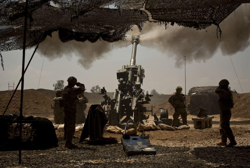 U.S. soldiers from the 82nd Airborne Division fire artillery in support of Iraqi forces fighting Islamic State militants from their bas...