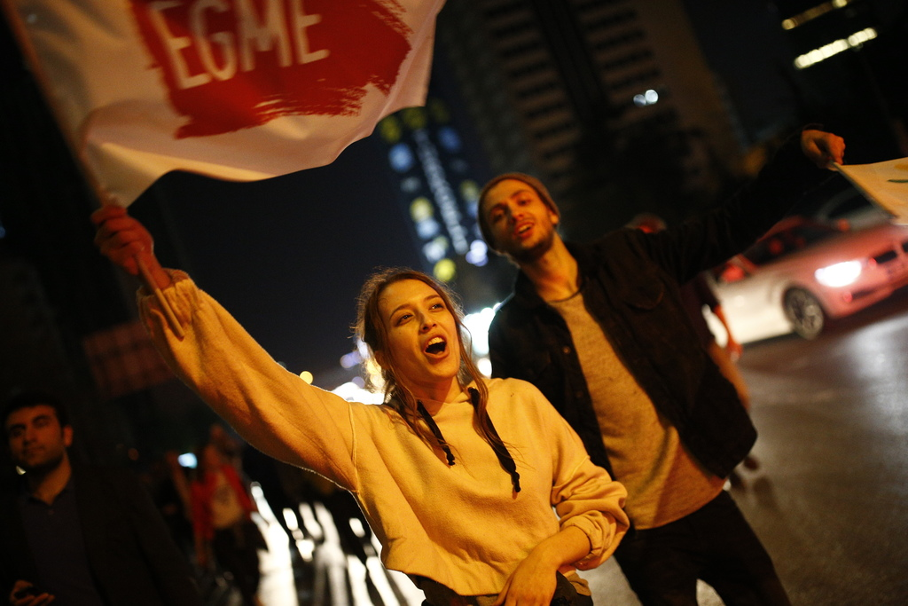 Supporters of pro-'no' vote chant slogans as they protest against the referendum outcome, in Istanbul, early Monday, April 17, 2017. Hu...