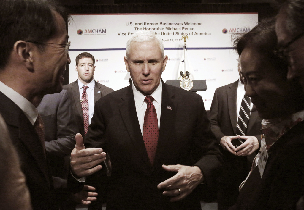U.S. Vice President Mike Pence talks with members of the American Chamber of Commerce at the Grand Hyatt Hotel in Seoul, South Korea, T...
