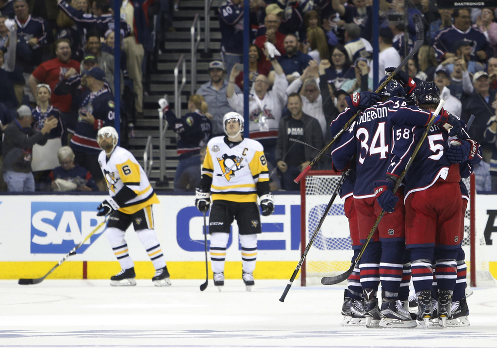 Columbus Blue Jackets celebrate a goal against the Pittsburgh Penguins during the first period of Game 4 of an NHL first-round hockey p...