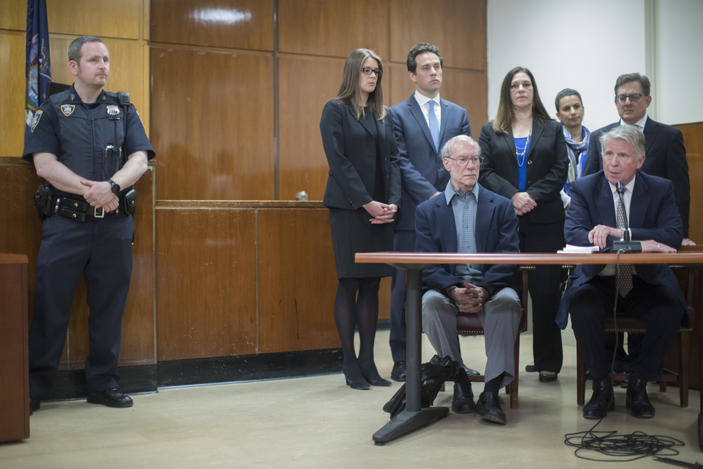 Stan Patz, foreground left, father of 6-year-old Etan Patz, is joined by Manhattan District Attorney Cy Vance, foreground right, Assist...