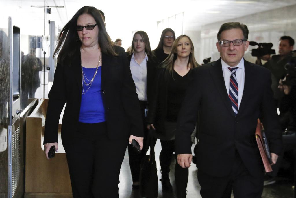 Assistant District Attorneys Joan Illuzzi-Osborn, left, and Joel Seidemann arrive at Manhattan Supreme Court, in New York, Tuesday, Apr...