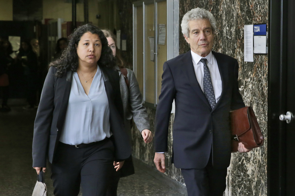 Defense attorneys Alice Fontier and Harvey Fishbein leave Manhattan Supreme Court, in New York, Tuesday, April 18, 2017, after the sent...