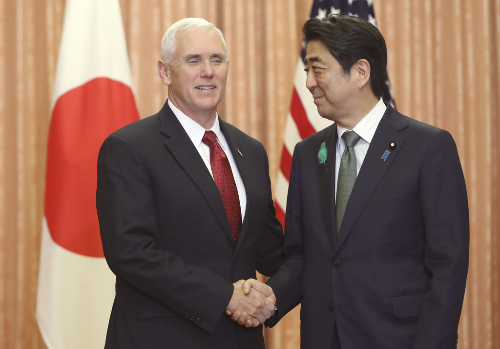 Japanese Prime Minister Shinzo Abe, right, and U.S. Vice President Mike Pence shake hands prior to a luncheon hosted by Abe at the prim...