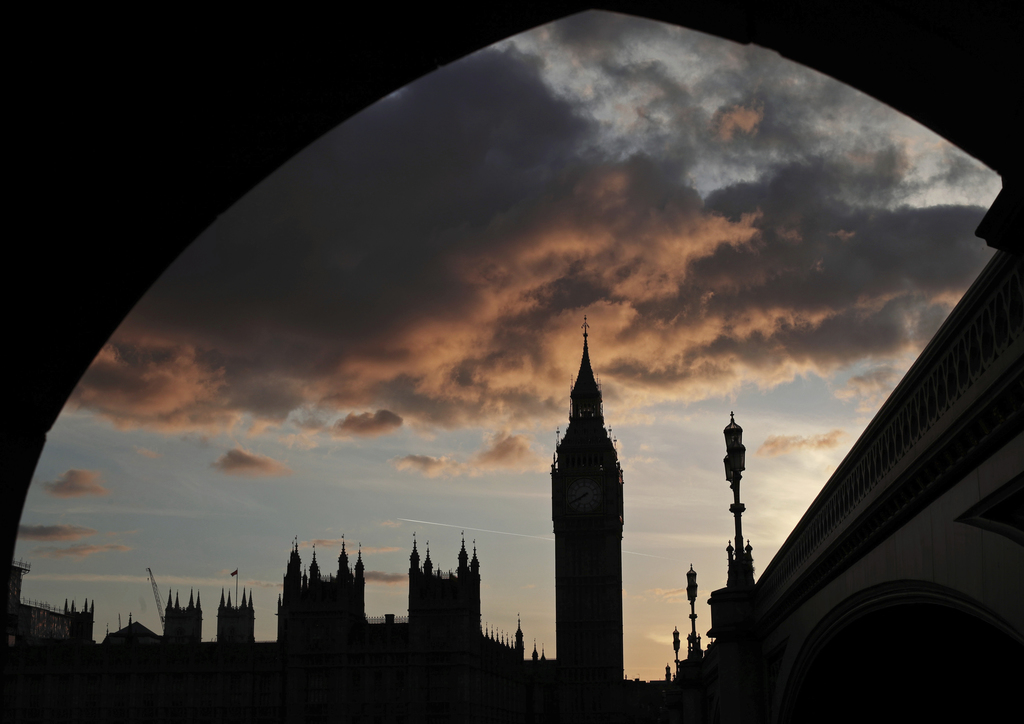 A silhouette of the Houses of Parliament and Elizabeth Tower containing Big Ben, centre, at dusk, in Westminster, London, Tuesday April...