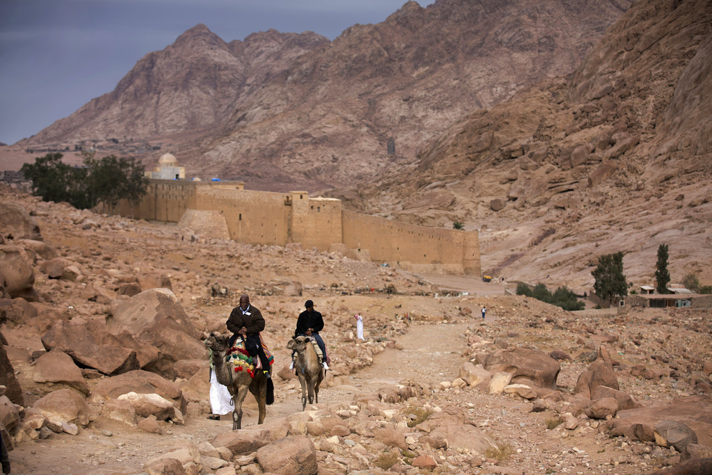 FILE -- In this Dec. 9, 2013 file photo, visitors leave Saint Catherine's Monastery on camels, in Saint Catherine, Egypt. The Islamic S...