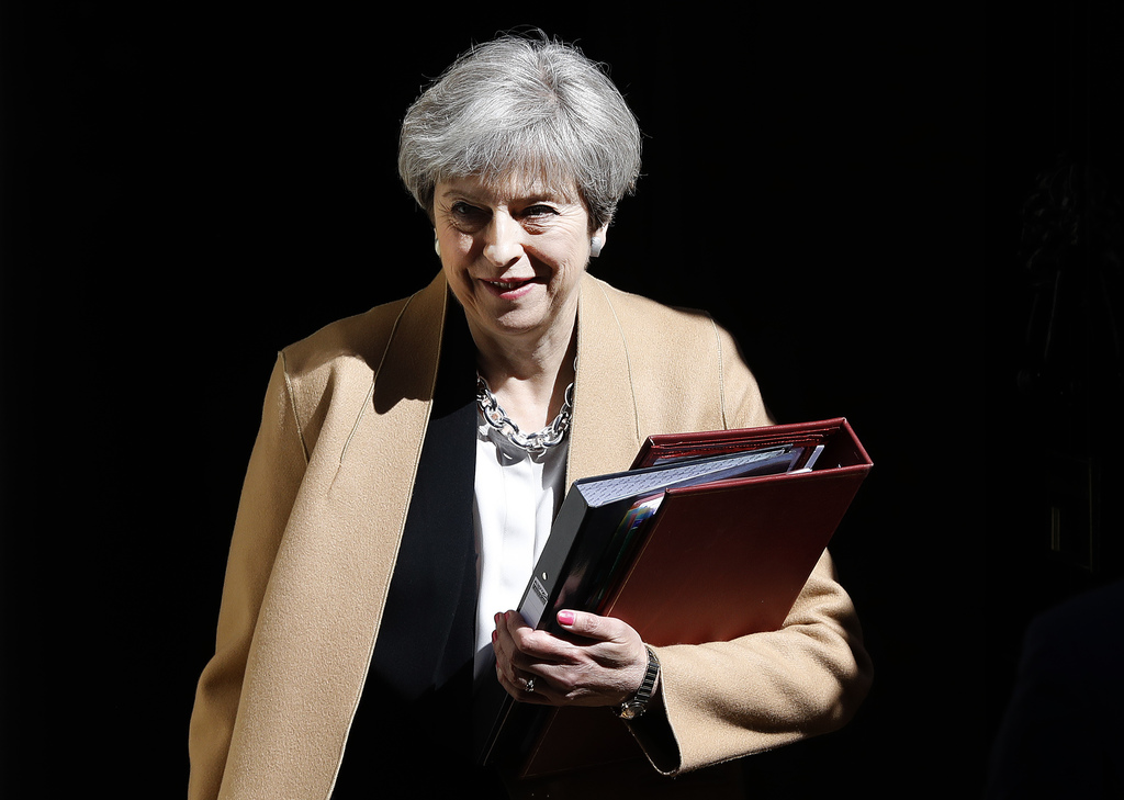 Britain's Prime Minister Theresa May departs 10 Downing Street in London  for Prime Minister's Questions in the Houses of Parliament We...