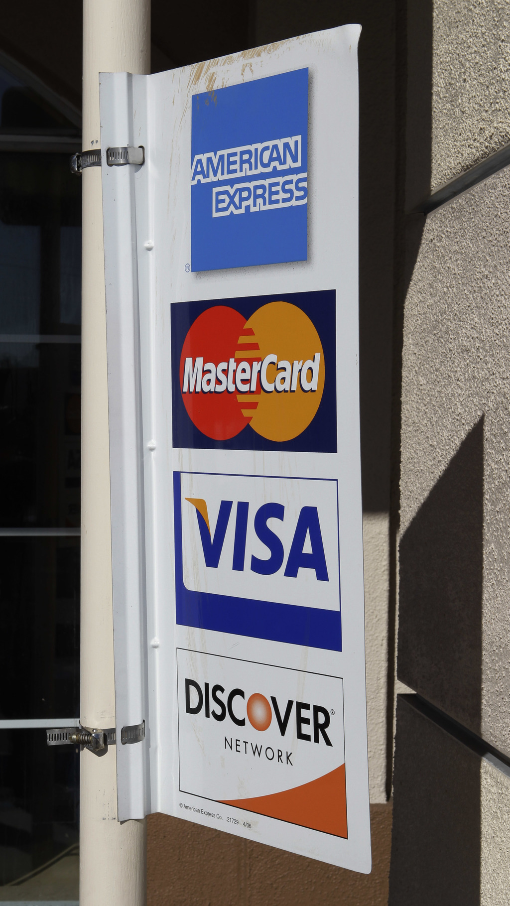 FILE - In this Jan. 18, 2011, file photo, four major credit cards advertise at a restaurant in Millbrae, Calif. The math behind your cr...