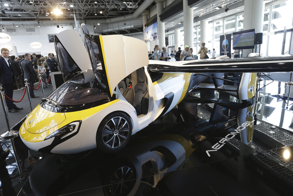 AeroMobil display their latest prototype of a flying car, in Monaco, Thursday, April 20, 2017. The light frame plane whose wings can fo...