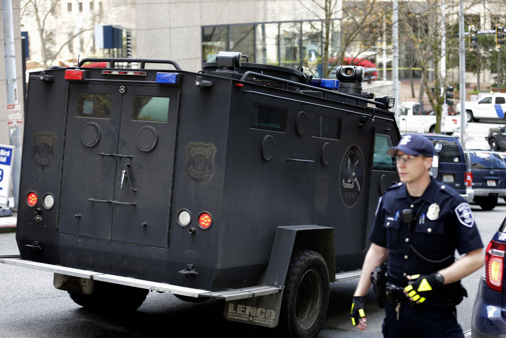 A Seattle Police SWAT vehicle drives near the scene of a shooting involving several police officers in downtown Seattle, Thursday, Apri...