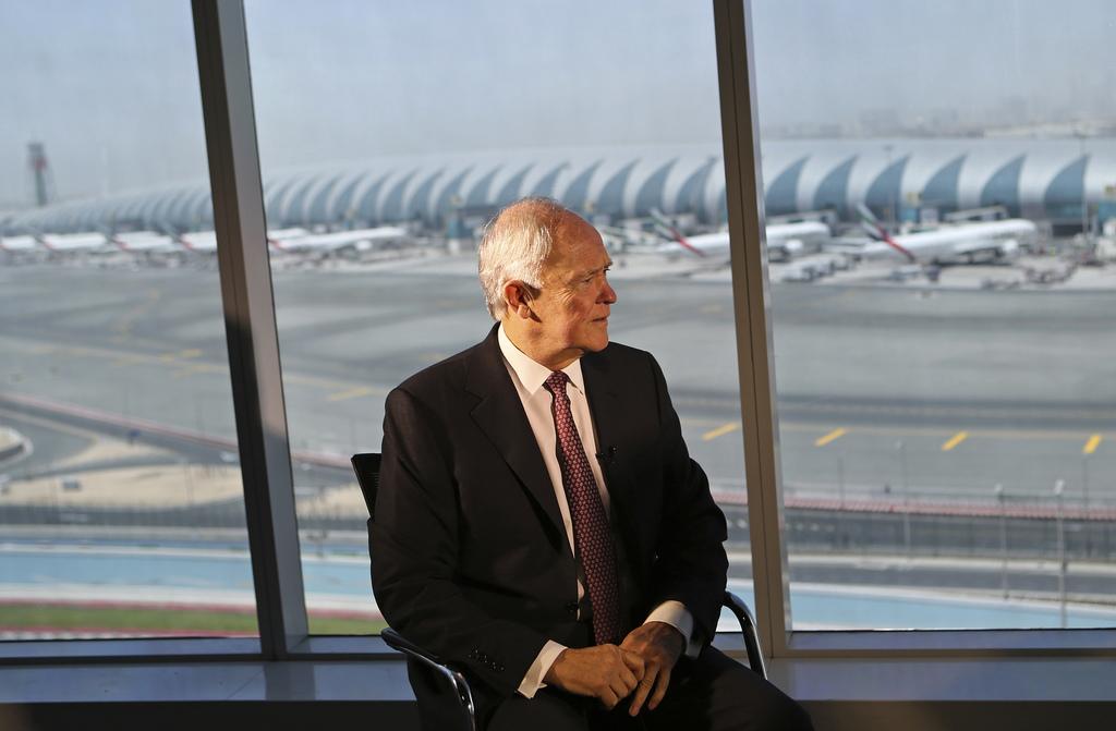 Emirates airline President Tim Clark talks to Associated Press reporter during an interview overlooking Dubai International Airport at ...