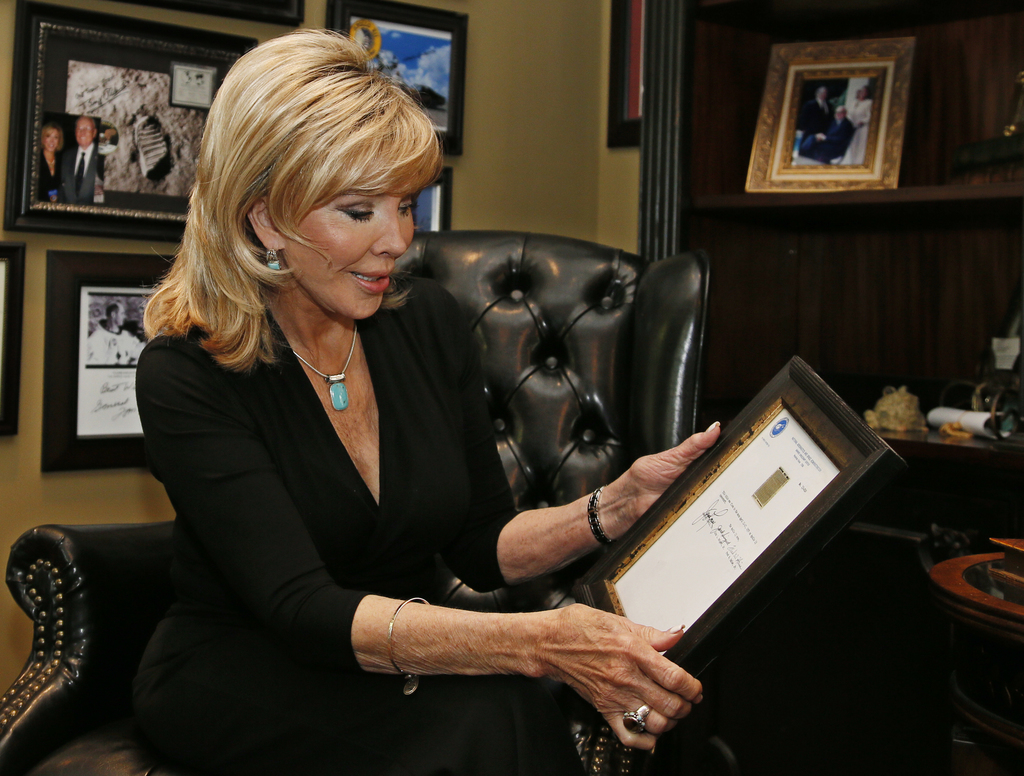 In this Tuesday, April 18, 2017 photo, Carol Mersch looks over the certificate she received along with a copy of a microfilm Bible that...