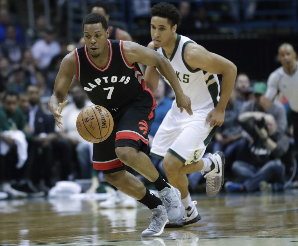 Toronto Raptors' Kyle Lowry steals the ball from Milwaukee Bucks' Malcolm Brogdon during the first half of Game 4 of an NBA first-round...