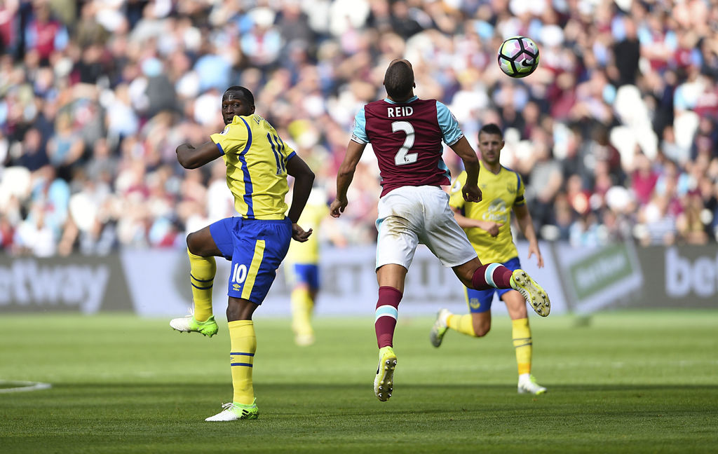 Everton's Romelu Lukaku left and West Ham's Winston Reid battle for the ball during the English Premier League soccer match between W