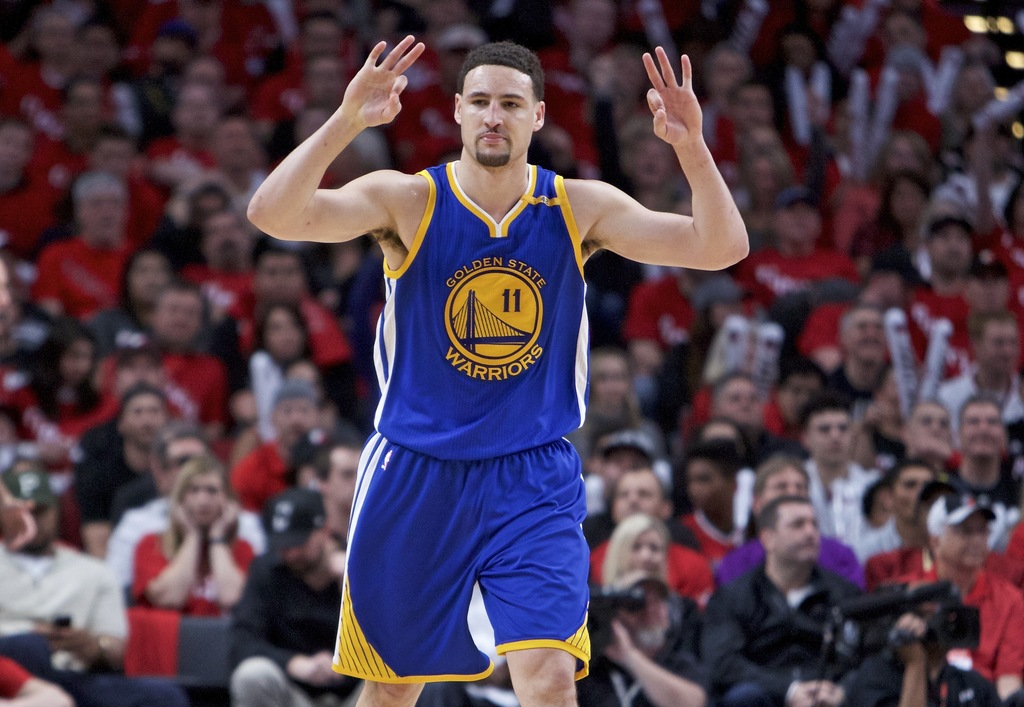 Golden State Warriors guard Klay Thompson reacts after making a three-point basket against the Portland Trail Blazers during the second...