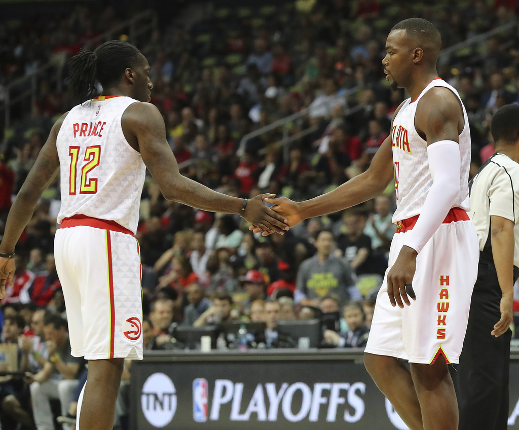Atlanta Hawks' Paul Millsap, right, gets five from Taurean Prince after drawing a foul from the Washington Wizards during Game 3 of an ...