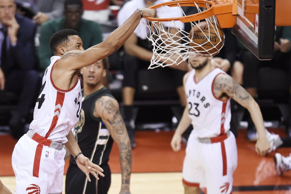 Toronto Raptors guard Norman Powell (24) dunks the ball against the Milwaukee Bucks during the second half of game five of an NBA first...