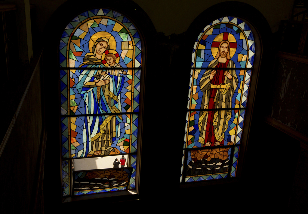 People are seen through the stain glass, of the Coptic church of Mar Girgis, in Cairo, Egypt, Monday, April 24, 2017. Pope Francis is s...