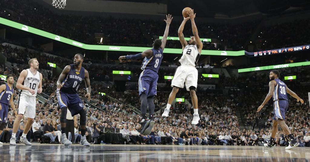 San Antonio Spurs forward Kawhi Leonard (2) shoots over Memphis Grizzlies forward James Ennis III (8) during the second half of Game 5 ...