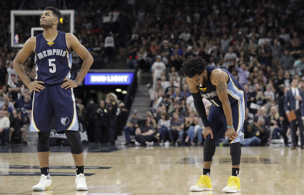 Memphis Grizzlies guard Andrew Harrison (5) and Memphis Grizzlies guard Mike Conley (11) stand on the court during the second half of G...