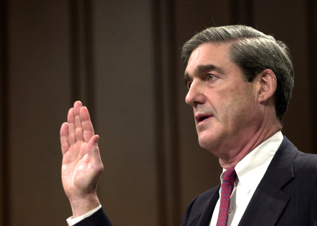FILE - In this July 30, 2001, file photo, Robert Mueller is sworn in at the start of his testimony during his confirmation hearing befo...